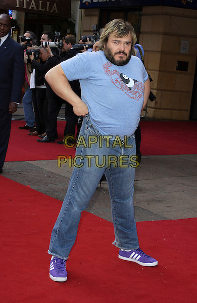 "JACK BLACK.UK Premiere of ""Kung Fu Panda"" held at the Vue West End,London, England, UK,.June 26th 2008..full length jeans blue panda motif t-shirt purple adidas trainers pulling up funny.CAP/ROS.©Steve Ross/Capital Pictures"