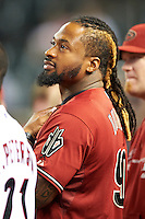 Arizona Diamondbacks guest Darnell Dockett #90 of the Arizona Cardinals before throwing out a first pitch before a National League regular season game against the Colorado Rockies at Chase Field on October 2, 2012 in Phoenix, Arizona. Arizona defeated Colorado 5-3. (Mike Janes/Four Seam Images)