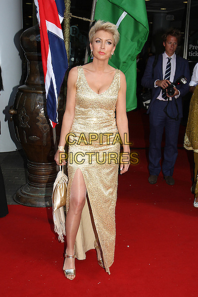 HEATHER MILLS .Royal Film Premiere of 'Arabia 3D' at the BFI Imax cinema, Waterloo, London, England, UK, May 24th 2010 . .arrivals  full length sleeveless long maxi dress slit split sandals leg thigh gold sequined sequin bag  .CAP/MAR.© Martin Harris/Capital Pictures.