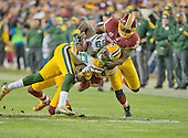 Green Bay Packers wide receiver James Jones (89) is tackled by Washington Redskins free safety Dashon Goldson (38) and Washington cornerback Bashaud Breeland (26) in the second quarter in an NFC Wild Card game at FedEx Field in Landover, Maryland on Sunday, January 10, 2016.  The Packers won the game 35 - 18.<br /> Credit: Ron Sachs / CNP