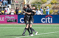 Kelley O'Hara and Marta celebrate Marta's late goal. FC Gold Pride defeated the Philadelphia Independence 4-0 to win the 2010 WPS Championship at Pioneer Stadium in Hayward, California on September 26th, 2010.