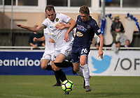 Team Wellington's Taylor Schrijvers and Auckland's Callum Mccowatt compete for the ball during the 2018 OFC Champions League semifinal between Auckland City FC and Team Wellington at Kiwitea St in Auckland, New Zealand on Sunday, 29 April 2018. Photo: Dave Lintott / lintottphoto.co.nz