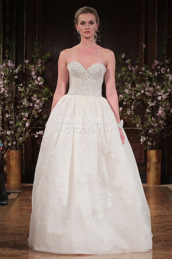 """Model walks runway in an """"Alex"""" bridal gown from the Isabelle Armstrong Spring Collection 2017, at Lotte New York Palace Hotel, during New York Bridal Fashion Week Spring Summer 2017 on April 16, 2017."""