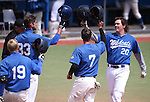 Wildcats' Kody Reynolds, right, is greeted at the plate by teammates after hitting a two-run homer against Utah State University Eastern at Western Nevada College in Carson City, Nev., on Saturday, April 25, 2015. WNC won 7-1.<br /> Photo by Cathleen Allison