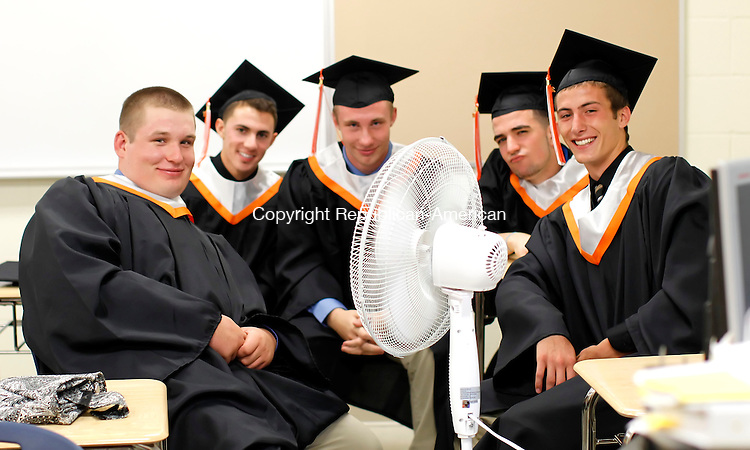 Watertown, CT- 17, April 2011-061711CM05  Jeremy Plourde (left) poses with fellow classmates before the start of Watertown High School's commencement exercises Friday night.   Christopher Massa Republican-American