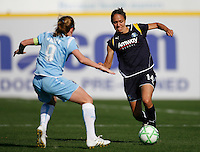 Stephanie Cox (14) of the Los Angeles Sol is defended by Heather O'Reilly (9) of Sky Blue FC. The Los Angeles Sol defeated Sky Blue FC 2-0 during a Women's Professional Soccer match at TD Bank Ballpark in Bridgewater, NJ, on April 5, 2009. Photo by Howard C. Smith/isiphotos.com