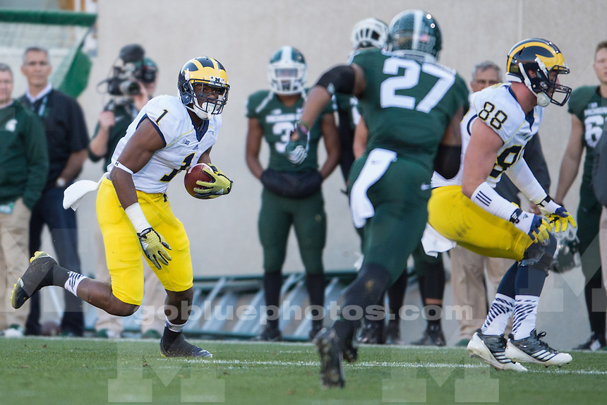 The University of Michigan football team loses, 35-11, to Michigan State University at Spartan Stadium in East Lansing on Oct. 25, 2014.