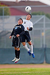 Torrance, CA 02/23/11 - Justin Kim (Bishop Montgomery #5) and Jovani Zayas (Salesian #10) in action during the second round CIF playoffs between Bishop Montgomery and Salesian.