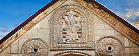 Pictures & images of Nikortsminda ( Nicortsminda ) St Nicholas Georgian Orthodox Cathedral exterior and its Georgian relief sculpture stonework depicting a saint, probably St Nicholas, above the main entrance, 11th century, Nikortsminda, Racha region of Georgia (country). A UNESCO World Heritage Tentative Site.