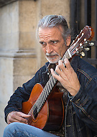 Stephen Lyman, musician, playing the Bach Lute Suites on the steps leading to the ecclesiastical garden at the rear of Eglise Saint Germain des Prés, adjoining Rue de l'Abbaye, Paris. Tuesday 23rd October 2012.