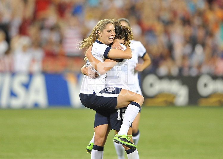 Morgan Brian (25) of the USWNT celebrates with teammate Lauren Holiday her score. The USWNT defeated Mexico 7-0 during an international friendly, at RFK Stadium, Tuesday September 3, 2013.