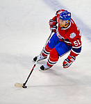 20 December 2008: Montreal Canadiens' defenseman Francis Bouillon carries the puck up ice during the third period against the Buffalo Sabres at the Bell Centre in Montreal, Quebec, Canada. With both teams coming off wins, the Canadiens extended their winning streak by defeating the Sabres 4-3 in overtime. ***** Editorial Sales Only ***** Mandatory Photo Credit: Ed Wolfstein Photo