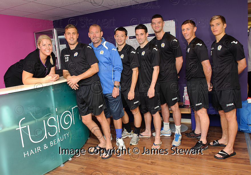 Linda Beattie from Cumbernauld college welcomes Queen of the South players who are being treated to a massage as a treat for putting Rangers out of the Ramsden Cup ...