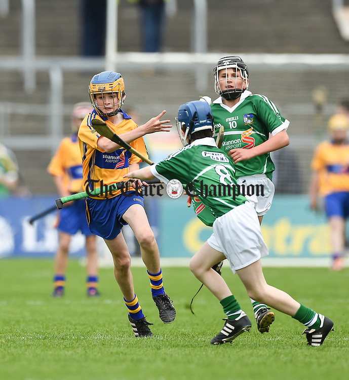Cian Galvin of Clare in action against Patrick O Donovan of Limerick during their Primary Game at Thurles Photograph by John Kelly.