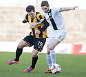 East Fife's Liam Buchanan and Ayr Utd's Gordon Pope challenge for the ball.