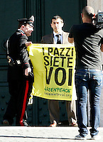 Un attivista di Greenpeace tenta di esporre uno striscione contro il nucleare davanti a Montecitorio, Roma, 18 maggio 2011..An activist of Greenpeace is faced by a Carabinieri officer as he try to exhibit an antinuclear banner in front of the Lower Chamber, Rome, 18 may 2011. A referendum on nuclear power in Italy is scheduled for 12 and 13 june..UPDATE IMAGES PRESS/Riccardo De Luca