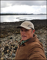 BNPS.co.uk (01202 558833)Pic: ShaunKrijnen/BNPS<br /> <br /> Marine biologist and oyster farmer Shaun Krijnen at the Menai Strait in Anglesea, Wales.<br /> <br /> Claws for thought...<br /> <br /> Divers and fishermen will need to be careful not to have a run-in with the monster that left this giant claw behind.<br /> <br /> The massive lobster, which must be at least 50 years old and about 3ft in length, is believed to be lurking in the Menai Strait in Anglesea, Wales.<br /> <br /> Marine biologist and oyster farmer Shaun Krijnen found the huge crushing claw the crustacean had shed when he pulled in one of his oyster bags last week.<br /> <br /> The claw is bigger than a human hand at a whopping 8 inches and it would be powerful enough to squash a tin can or break a human wrist.
