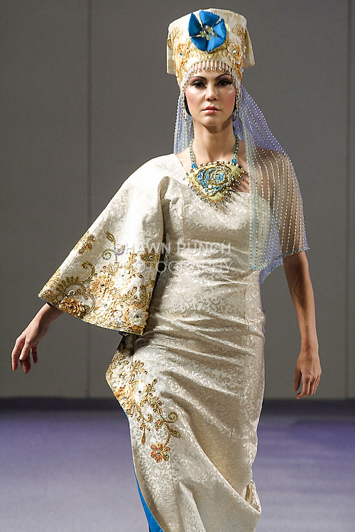 Model walks runway in a bridal dress from the Evgenia Luzhina-Salazar Spring 2013 collection, during Couture Fashion Week Spring 2013 in NYC, on September 16, 2012.