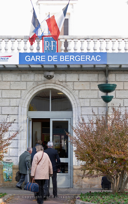 The Bergerac train station. People passengers walking through the door carrying baggage. Bergerac Dordogne France