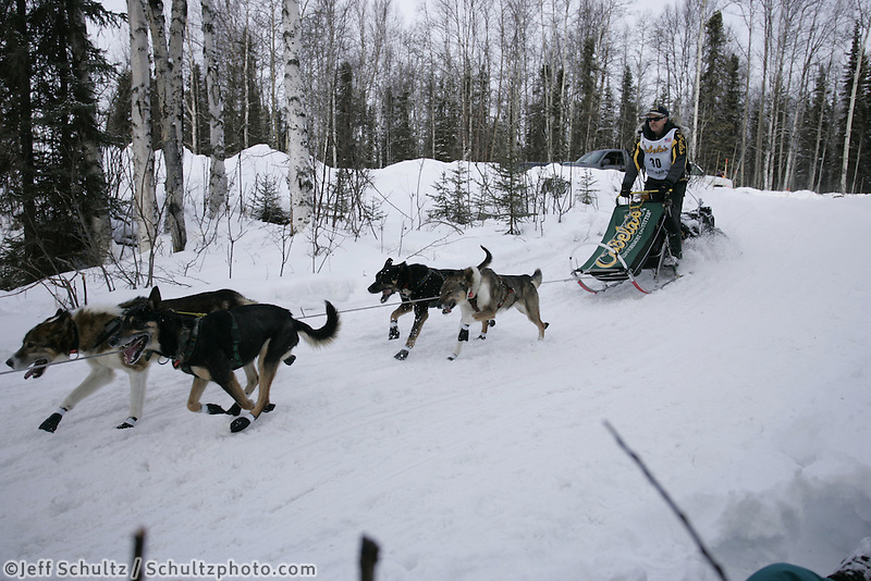 Jeff King on the trail near Long Lake during the Iditarod restart on Sunday in Willow, Alaska
