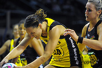 Jodi Brown takes a pass under pressure from Leana De Bruin during the ANZ Netball Championship match between the Central Pulse and Waikato Bay Of Plenty Magic at TSB Bank Arena, Wellington, New Zealand on Monday, 30 March 2015. Photo: Dave Lintott / lintottphoto.co.nz
