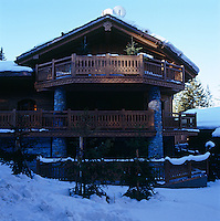 The exterior of the wooden chalet with its many balconies and terraces