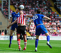 Lincoln City's Matt Rhead vies for possession with Tranmere Rovers' Sid Nelson, left, and Tranmere Rovers' Oliver Banks<br /> <br /> Photographer Chris Vaughan/CameraSport<br /> <br /> The EFL Sky Bet League Two - Lincoln City v Tranmere Rovers - Monday 22nd April 2019 - Sincil Bank - Lincoln<br /> <br /> World Copyright © 2019 CameraSport. All rights reserved. 43 Linden Ave. Countesthorpe. Leicester. England. LE8 5PG - Tel: +44 (0) 116 277 4147 - admin@camerasport.com - www.camerasport.com