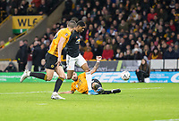 4th January 2020; Molineux Stadium, Wolverhampton, West Midlands, England; English FA Cup Football, Wolverhampton Wanderers versus Manchester United; Marcus Rashford of Manchester United with the ball at his feet as Diogo Jota of Wolverhampton Wanderers does a sliding tackle for the ball - Strictly Editorial Use Only. No use with unauthorized audio, video, data, fixture lists, club/league logos or 'live' services. Online in-match use limited to 120 images, no video emulation. No use in betting, games or single club/league/player publications