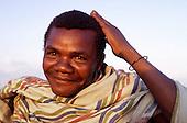 Near Dodoma, Tanzania. Smiling man wearing tribal bracelet and cotton wrap.