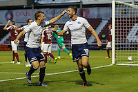 Dan Rowe of Wycombe Wanderers (right) celebrates scoring the opening goal with Dayle Southwell of Wycombe Wanderers (left) during The Checkatrade Trophy match between Northampton Town and Wycombe Wanderers at Sixfields Stadium, Northampton, England on 30 August 2016. Photo by David Horn / PRiME Media Images.