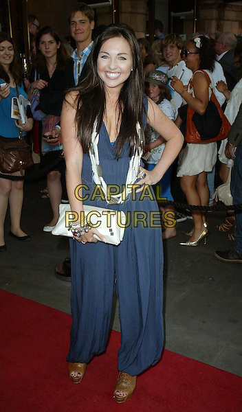 "LOUISA LYTTON.""Priscilla: Queen Of The Desert The Musical"" - Cast Change, London, England, UK..June 22nd, 2010.arrivals full length hand on hip blue navy catsuit jumpsuit brown open toe platform booties shoes wedges necklace cream clutch bag.CAP/WIZ.© Wizard/Capital Pictures."