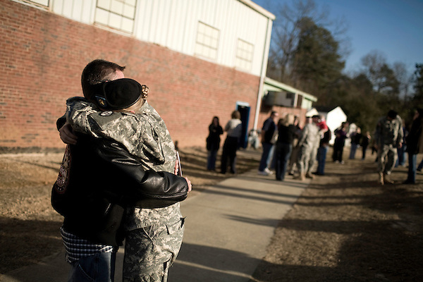 December 13, 2008. Erwin, North Carolina.. Mike Swygert and his wife Sgt. Patricia Swygert say goodbye as Patricia prepares to go back to Ft. Bragg to complete her training before heading to Iraq. The Swygert's were married on Nov. 28, 2008.. A deployment ceremony was held at Cape Fear Christian Academy for B Company 230th Brigade Support Battalion headquartered in Dunn, NC.. The unit is part of the North Carolina National Guard's 30th Heavy Brigade Combat Team, which has 4000 soldiers  deploying to Iraq in April after training. The 30th was last deployed to Iraq in 2003-2005.
