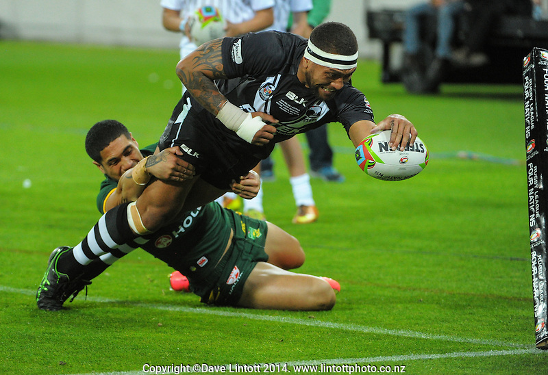 Manu Vatuvei scores in the corner during the Four Nations rugby league final between the NZ Kiwis and Australia Kangaroos at Westpac Stadium, Wellington on Saturday, 15 November 2014. Photo: Dave Lintott / lintottphoto.co.nz