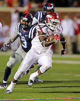 11/7/15<br /> Arkansas Democrat-Gazette/STEPHEN B. THORNTON<br /> Arkansas' Alex Collins turns upfield for a big gain in the third quarter  during the victory over Ole Miss during Saturday's game in Oxford, Miss.