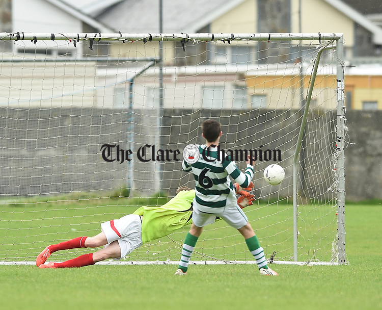 Colin Smyth of Newmarket Celtic fails to block the penalty kick of Sporting Ennistymon's James Mc Conigley during their Premier league game in Lahinch. Photograph by John Kelly.