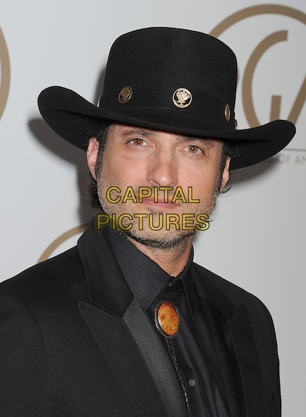 Robert Rodriguez.At the 24th Annual Producers Guild Awards held at the Beverly Hilton Hotel, Beverly Hills, California, USA,.26th January 2013..PGAs PGA arrivals portrait headshot black cowboy hat grey gray shirt tie suit beard facial hair stubble .CAP/ROT/TM.©Tony Michaels/Roth Stock/Capital Pictures