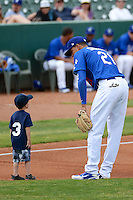 Ogden Raptors Alex Santana #21 with a young fan prior to the game against the Idaho Falls Chukars at Lindquist Field on June 23, 2013 in Ogden, Utah. (Stephen Smith/Four Seam Images)