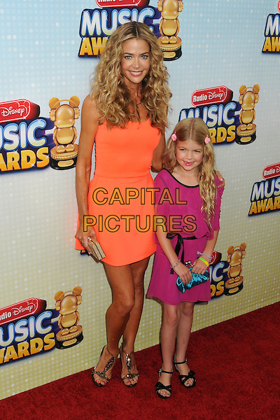 Denise Richards & daughter .At the Radio Disney Music Awards 2013 held at Nokia Theatre LA Live, Los Angeles, California, USA, .27th April 2013..full length orange dress smiling family pink mother mum mom .CAP/ADM/BP.©Byron Purvis/AdMedia/Capital Pictures