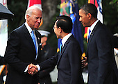 United States Vice President Joe Biden greets President Lee Myung-bak of South Korea as U.S. President Barack Obama watches during an arrival ceremony on the South Lawn at the White House in Washington, D.C. on Thursday, October 13, 2011.  .Credit: Kevin Dietsch / Pool via CNP