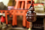 Suzu, Japanese Shinto shrine bell meant for making your presence known to Kami gods. Fushimi Inari Taisha shrine in Kyoto, Japan.