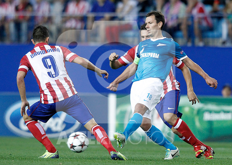 Atletico de Madrid's David Villa (l) and Koke (r) and Football Club Zenit's Konstantin Zyryanov during Champions League 2013/2014 match.September 18,2013. (ALTERPHOTOS/Acero)