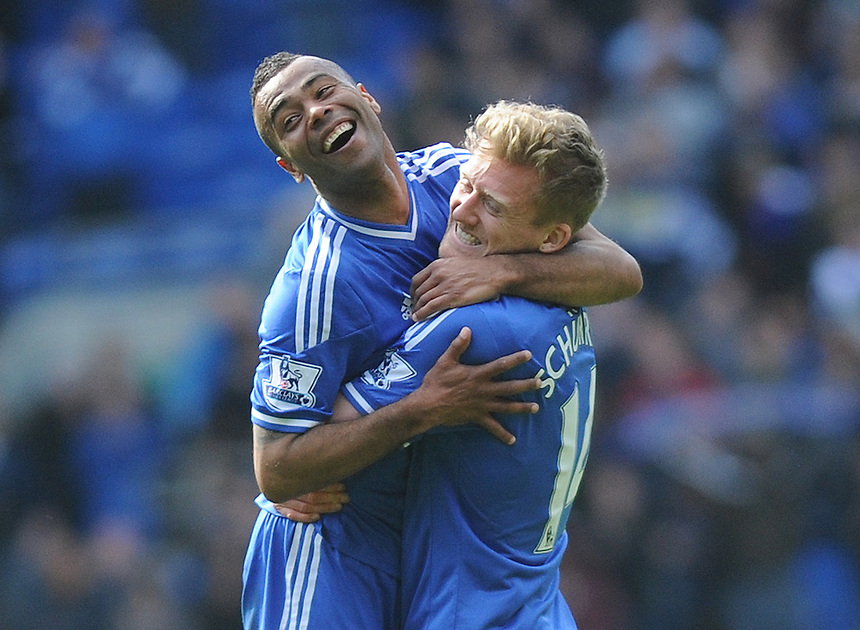 Chelsea's Ashley Cole and team mate Andre Schurrle celebrate at full time<br /> <br /> Photographer Ashley Crowden/CameraSport<br /> <br /> Football - Barclays Premiership - Cardiff City v Chelsea - Sunday 11th May 2014 - Cardifff City Stadium - Cardiff<br /> <br /> &copy; CameraSport - 43 Linden Ave. Countesthorpe. Leicester. England. LE8 5PG - Tel: +44 (0) 116 277 4147 - admin@camerasport.com - www.camerasport.com