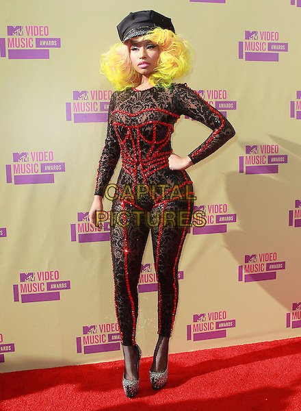 Nicki Minaj.The 2012 MTV Video Music Awards held at Staples Center in Los Angeles, California, USA..September 6th, 2012.VMA's VMAS VMA full length lace catsuit red sequins sequined detailing neon yellow pink hued hair hat silver shoes hand on hip.CAP/ADM/KB.©Kevan Brooks/AdMedia/Capital Pictures.