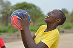 A student shoots the basketball during a game at the Loreto Girls Secondary School in Rumbek, South Sudan. The school is run by the Institute for the Blessed Virgin Mary--the Loreto Sisters--of Ireland.