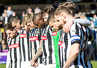 Notts County Players observe a minutes silence as a mark of respect to those who have lost their lives or were injured in the tragic attacks in Westminster London on the 22nd March 2017 during the Sky Bet League 2 match between Wycombe Wanderers and Notts County at Adams Park, High Wycombe, England on the 25th March 2017. Photo by Liam McAvoy.