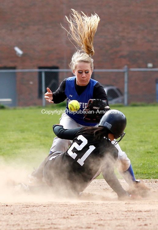 Thomaston, CT-27 April 2012-042712CM06-  Litchfield's Macie Longley can't hang onto the ball as Thomaston's Erin O'Neil slides safely into second after cracking a single  Friday afternoon in Thomaston.  The Bears won big, 12-5.     Christopher Massa Republican-American