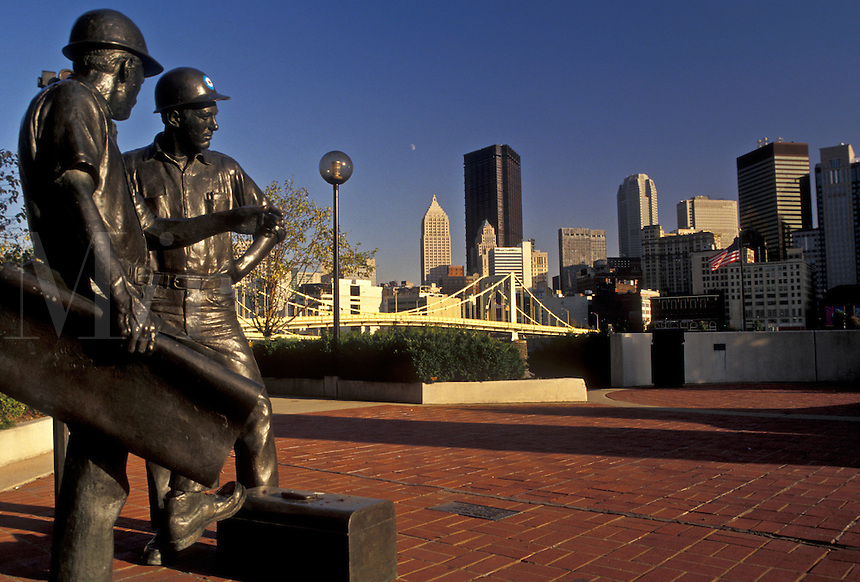 AJ3198, Pittsburgh, Pennsylvania, Mining statue at Allegheny Landing with a view of the downtown skyline of Pittsburgh in the background in the state of Pennsylvania.
