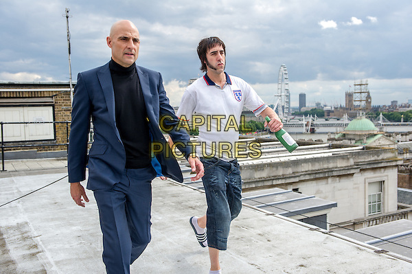 The Brothers Grimsby (2016)<br /> (Grimsby)  <br /> Mark Strong and Sacha Baron Cohen<br /> *Filmstill - Editorial Use Only*<br /> CAP/KFS<br /> Image supplied by Capital Pictures