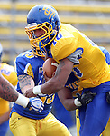 BROOKINGS, SD - APRIL 26:  Dom Wright #10 from South Dakota State's offense looks for yardage past the defense during their spring game Saturday at Coughlin Alumni Stadium in Brookings. (Photo by Dave Eggen/Inertia)