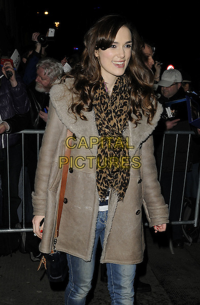 "KEIRA KNIGHTLEY.Leaving after the evening performance of ""The Misanthrope"", Comedy Theatre, London, England, UK, March 12th 2010..half length brown louis vuitton animal leopard print scarf beige grey gray sheepskin coat jeans shoulder bag striped top navy blue and white smiling .CAP/CAN.©Can Nguyen/Capital Pictures"